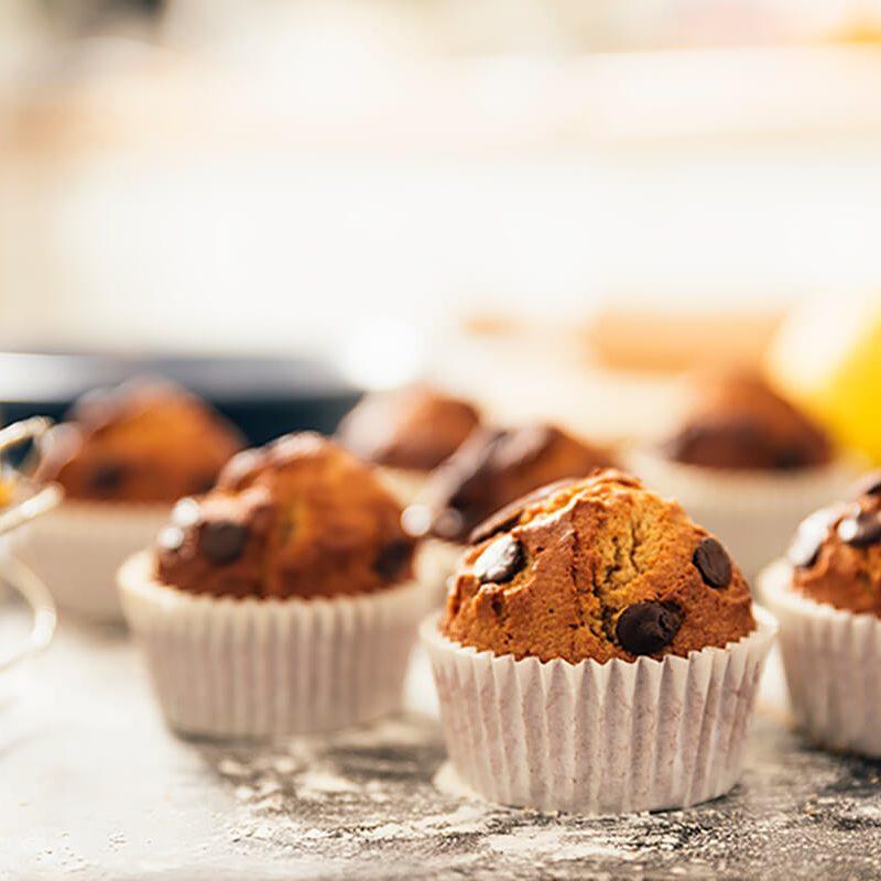 beautiful-woman-preparing-cx-ookies-and-muffins-Q22QSQ4.jpg